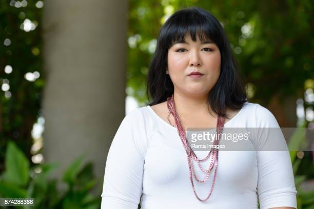 beautiful overweight asian woman getting away from it all with nature - fat asian woman stock pictures, royalty-free photos & images