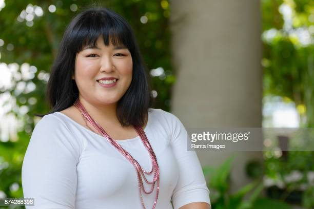 Woman Chubby Asian Short Hair Stock Photos And Pictures