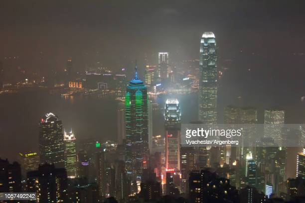 beautiful panoramic view of hong kong with city lights at night - argenberg stock pictures, royalty-free photos & images