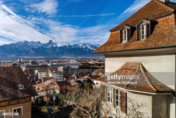 Beautiful panoramic view to the city Thun from the high point of view, blue sky and snowy Alps, Switzerland