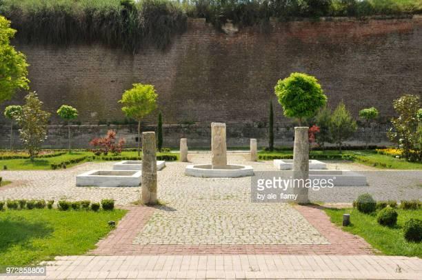 Alba Iulia, Romania - May 18, 2014: Beautiful park with trees and stone arrangements