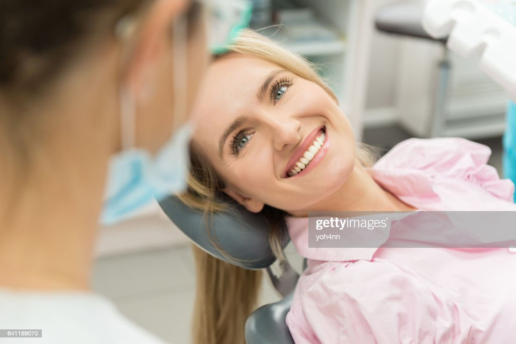 Beautiful patient smiling at doctor : Stock Photo