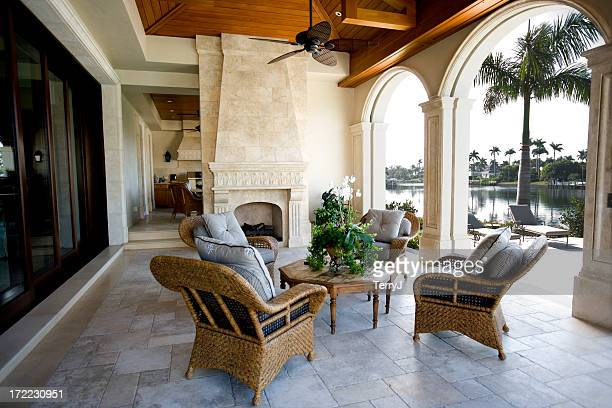 beautiful patio furniture at estate home overlooking bay - naples florida stock pictures, royalty-free photos & images