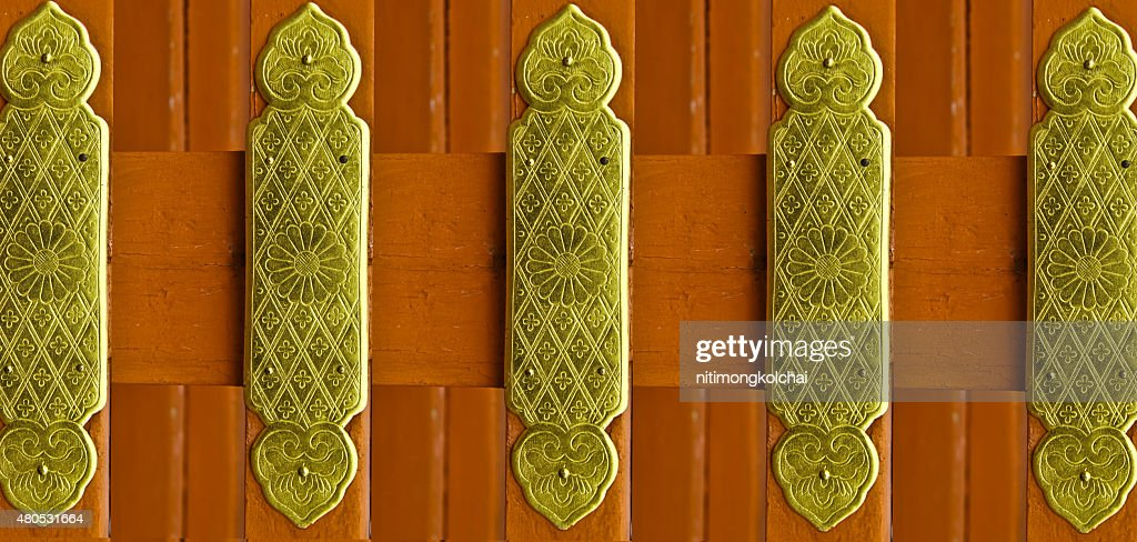 Beautiful patterns on a brass plate : Stock Photo