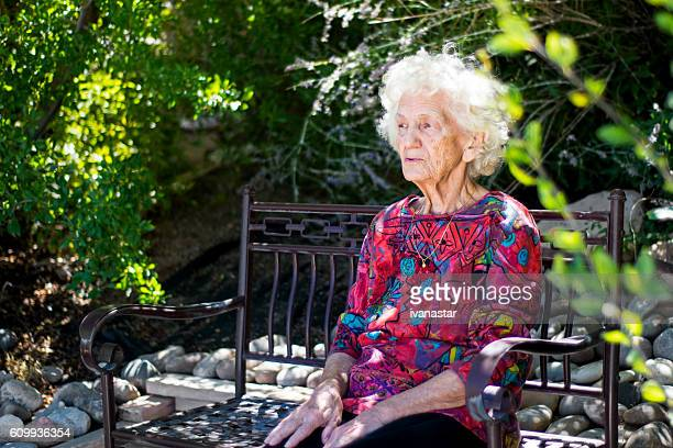 Beautiful Pensive Senior Woman Outdoors, Lost in Thoughts