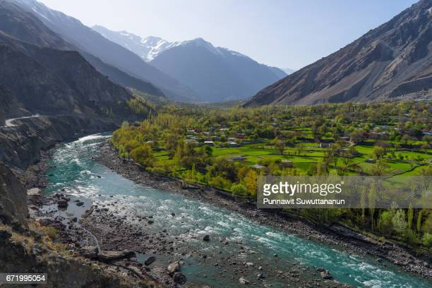 beautiful phander river and greeny village, phander valley, gilgit baltistan, pakistan - gilgit baltistan stock pictures, royalty-free photos & images
