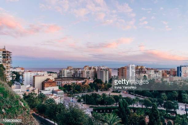 beautiful pink sunset over the city of malaga - malaga fotografías e imágenes de stock