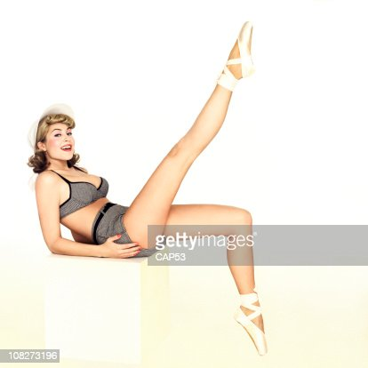 Teacher pinup girl sitting on school desk stock photo getty images keywords thecheapjerseys Gallery