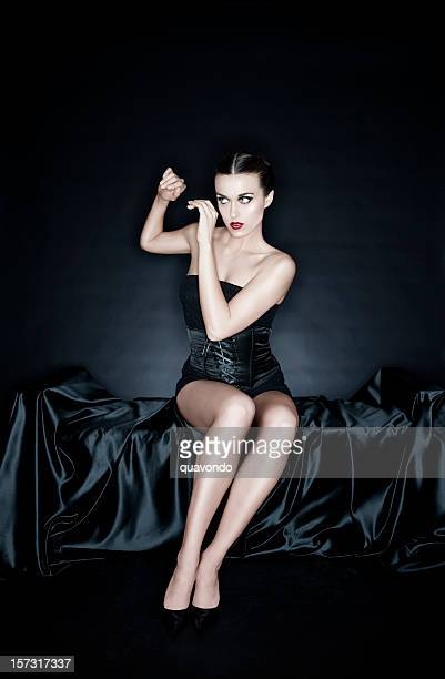 Beautiful Pinup Young Woman in Black Corset on Silk, Copyspace
