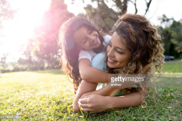 beautiful portrait of a mother playing with her daughter outdoors - latin american and hispanic ethnicity stock pictures, royalty-free photos & images