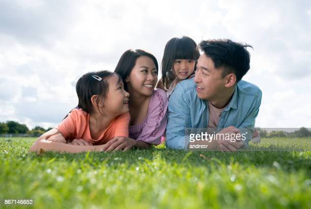beautiful portrait of an asian family outdoors - chinese family stock photos and pictures