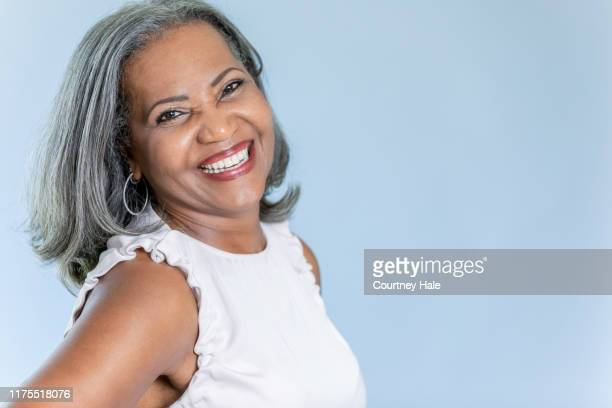 beautiful portrait of smiling senior woman with gray hair - white hair stock pictures, royalty-free photos & images