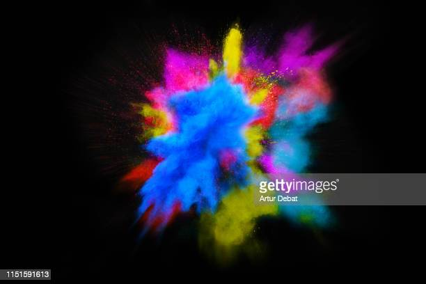 beautiful powder explosion in all directions with vivid colors and black background. - imagem a cores imagens e fotografias de stock
