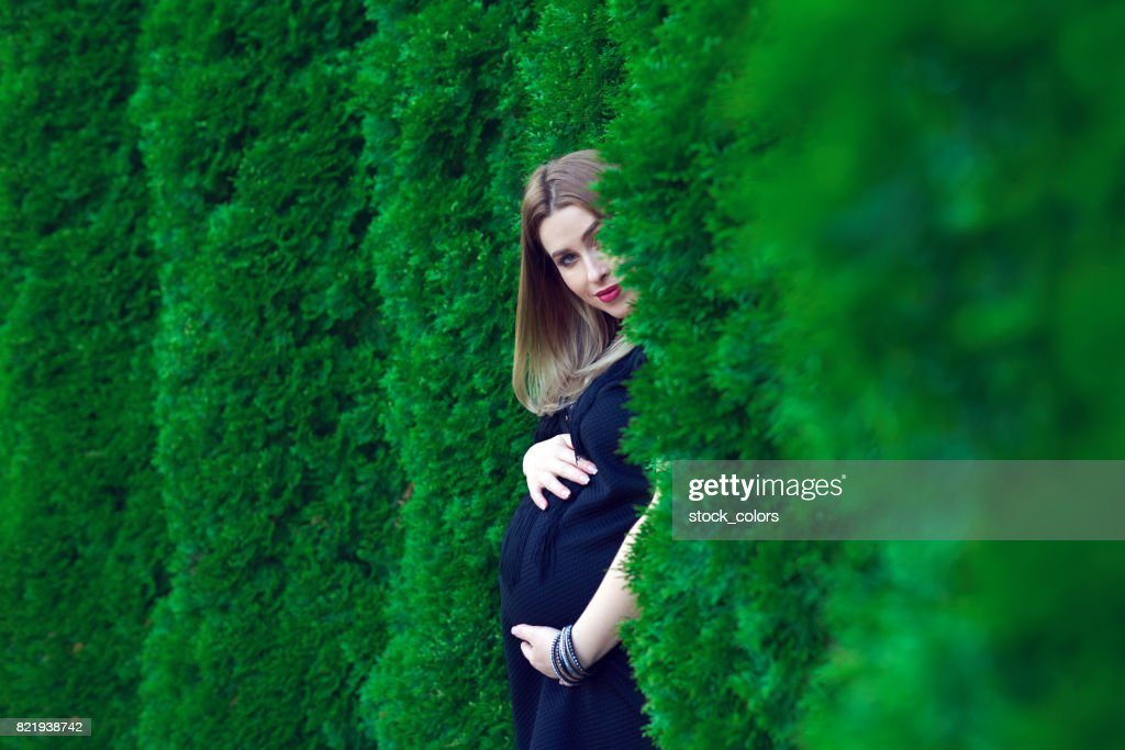 beautiful pregnant mother in nature : Stock Photo