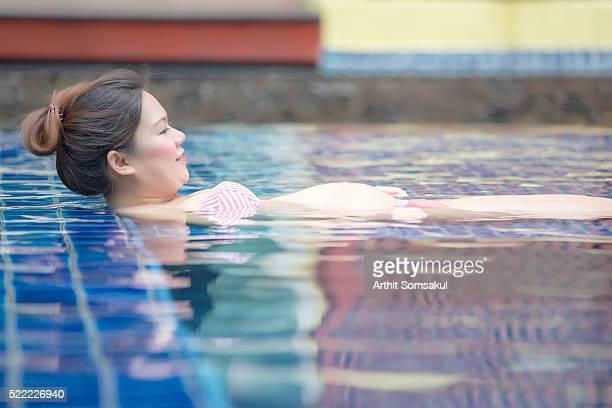 Beautiful pregnant woman in pool