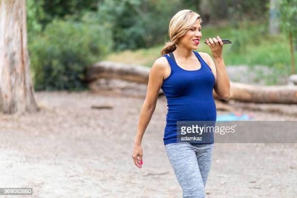 Beautiful Pregnant Woman Walking and Talking on Phone
