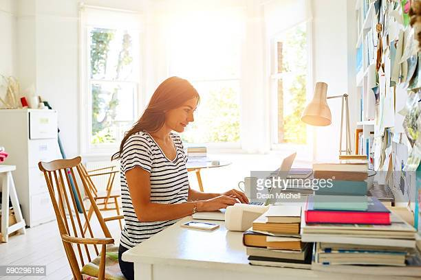 Beautiful pregnant woman working from home office