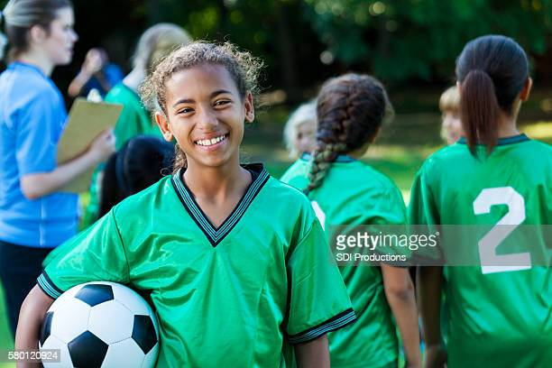 Beautiful preteen female soccer player
