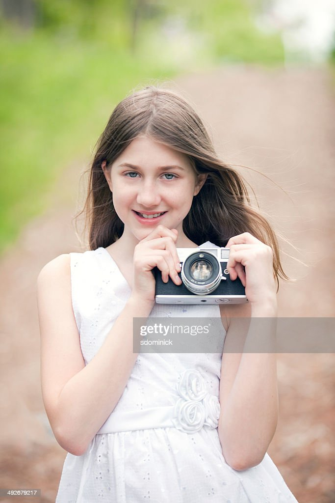 Preteen Girl With Digital Camera Royalty Free Stock Image