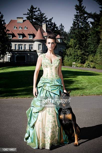 Beautiful Princess in Evening Gown with Doberman Outside a Castle