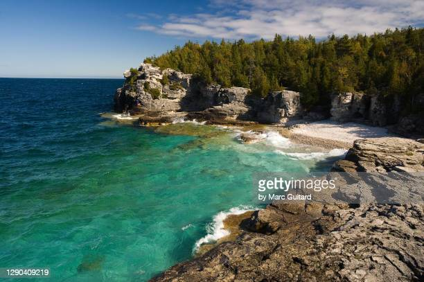 beautiful pristine waters of georgian bay, bruce peninsula national park, ontario, canada - ontario canada stock pictures, royalty-free photos & images