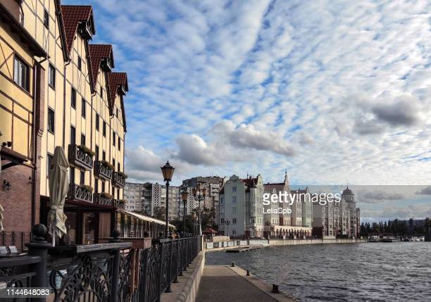 beautiful promenade of the river pregolya in the city center with a great sky - kaliningrad stock pictures, royalty-free photos & images