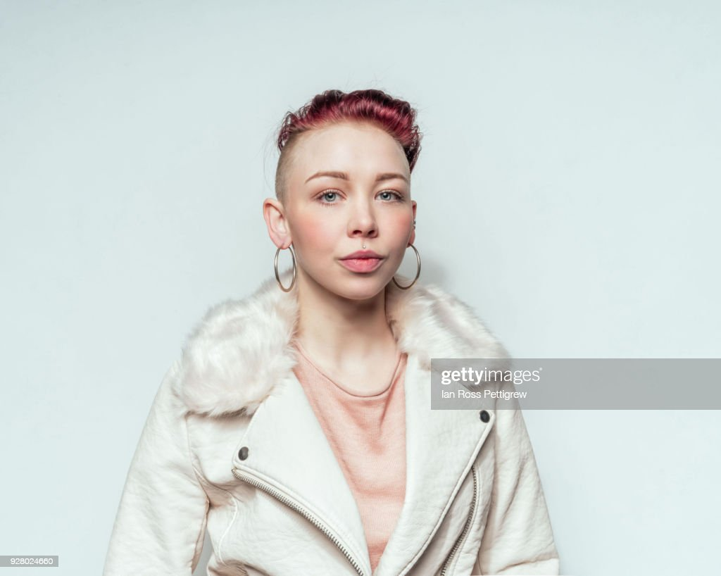Beautiful punk woman in white leather jacket : Stock Photo