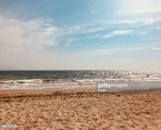 beautiful pure beach - cloudy stock photos and pictures