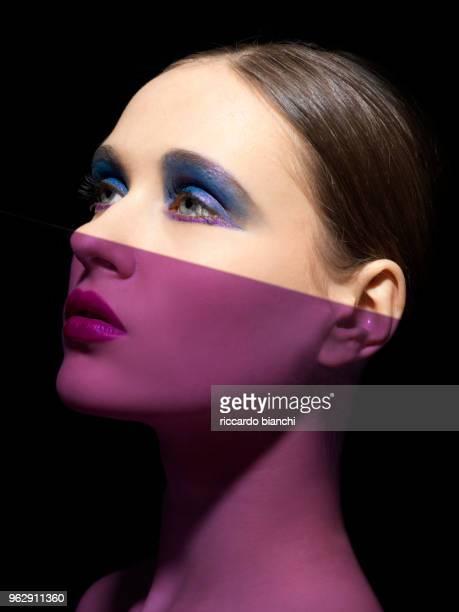 beautiful purple and white woman with blue and purple metallic eyeshadow