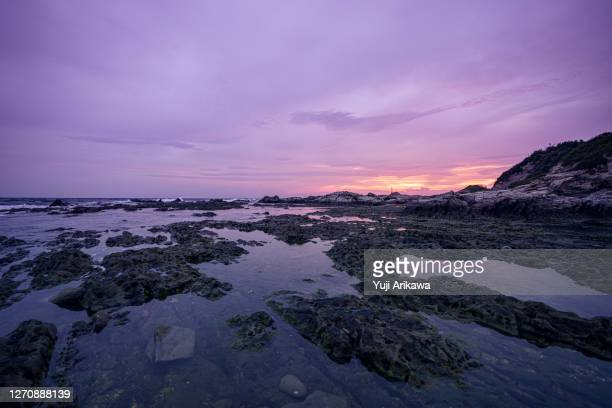 beautiful purple sunset reflected in the sea - chiba city stock pictures, royalty-free photos & images