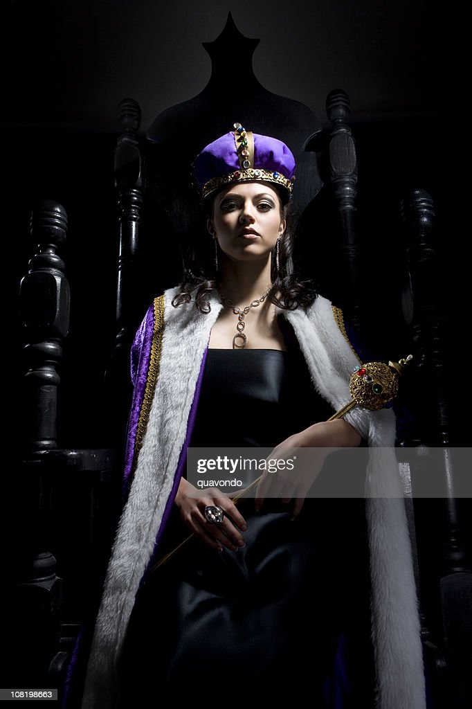 Black Throne with Beautiful Queen Holding Scepter : Stock Photo