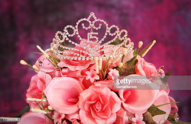 Beautiful Quinceanera Crown on top of pink flowers