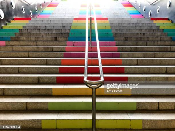 beautiful rainbow colors in the barcelona city street stairs. - stufen stock-fotos und bilder