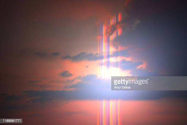 beautiful rainbow flare in the sunset sky with bright light. - image stock pictures, royalty-free photos & images