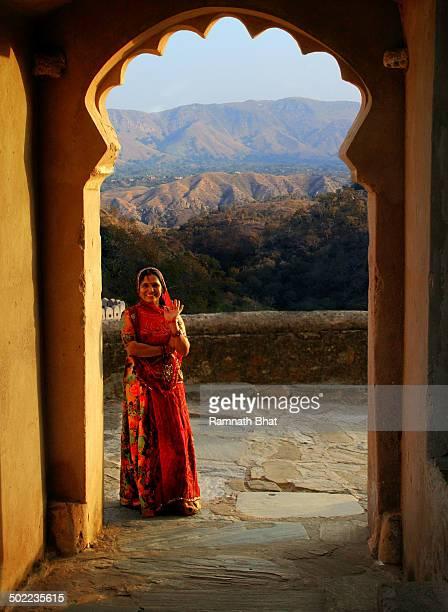 Beautiful Rajasthani woman standing in one of the gates of Kumbhalgarh Fort. Kumbhalgarh Fort, Rajashtan is one of the World Heritage sites of India....