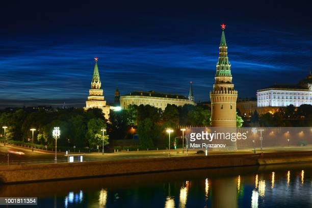 beautiful rare natural phenomenon of noctilucent clouds (night shining clouds) over the moscow kremlin at night. - light natural phenomenon stock photos and pictures