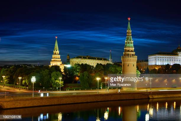 Beautiful rare natural phenomenon of Noctilucent clouds (night shining clouds) over the Moscow Kremlin at night.