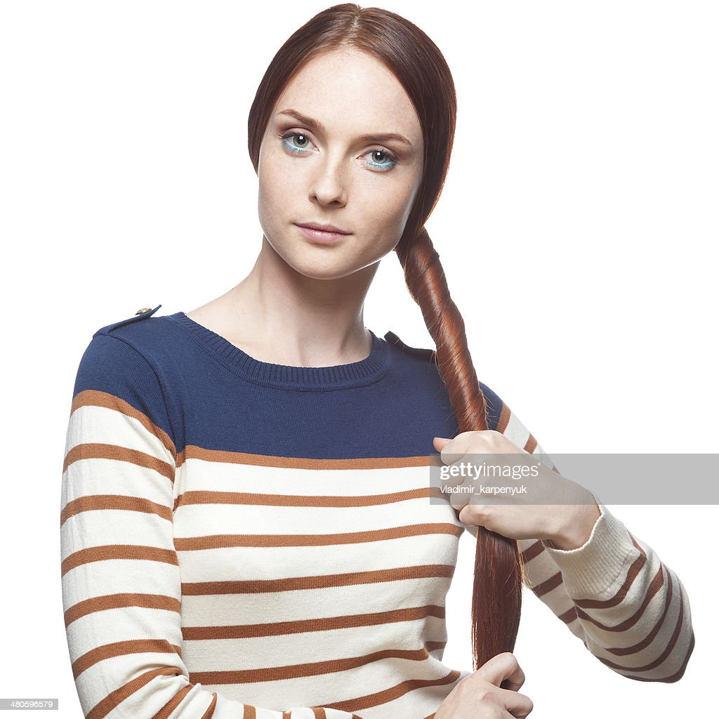 beautiful red haired girl holding her hair : Stock Photo