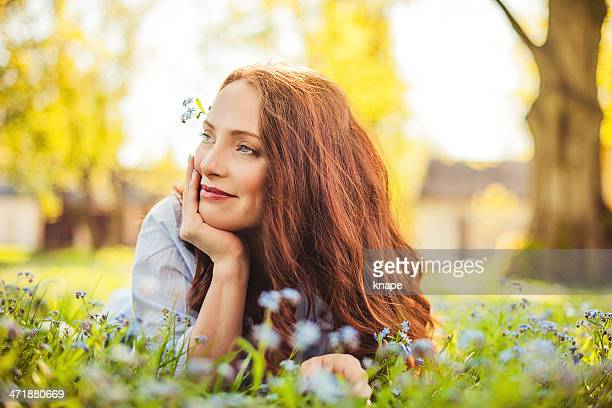 beautiful redhead outdoors - dyed red hair stock pictures, royalty-free photos & images