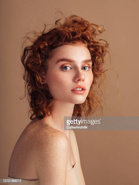 beautiful redhead woman - permed hair stock photos and pictures
