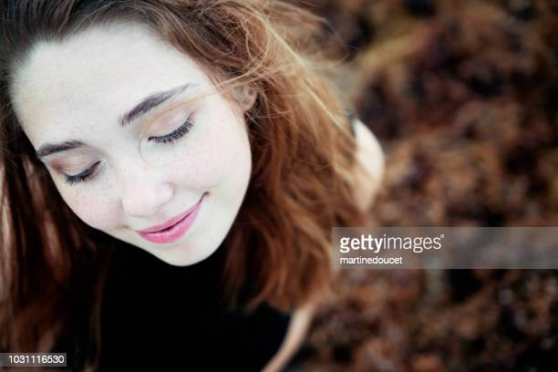 Beautiful redhead young woman portrait in nature