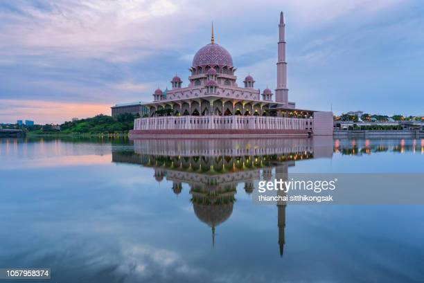 beautiful refection of sunrise and putra mosque - putrajaya stock photos and pictures
