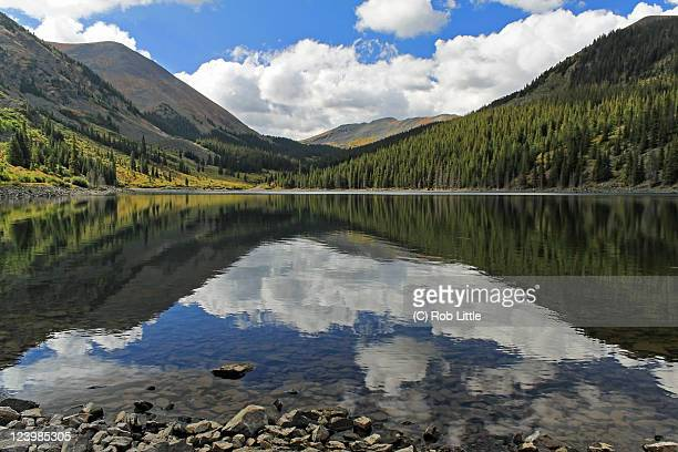 beautiful reflection of clouds on mirror lake - mirror lake stock pictures, royalty-free photos & images