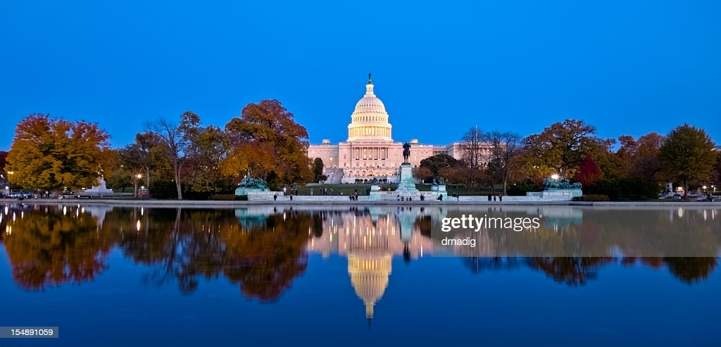 A beautiful reflection of United States Capitol at dawn : Stock Photo