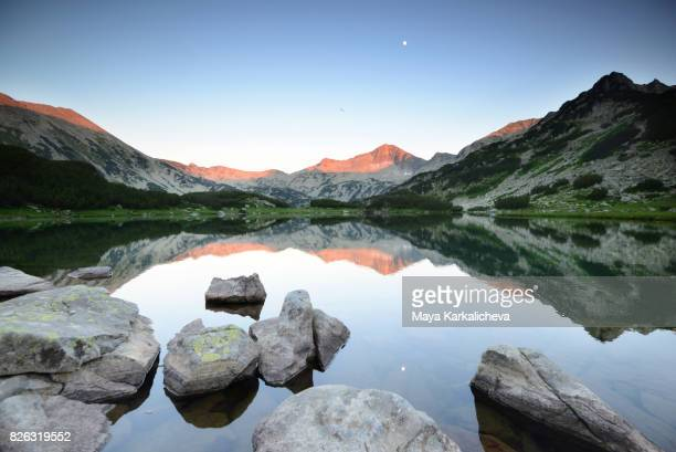 Beautiful reflections of peaks in a lake