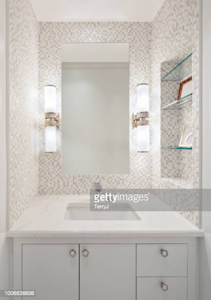 beautiful remodeled bathroom in a condominium - vanity mirror stock pictures, royalty-free photos & images