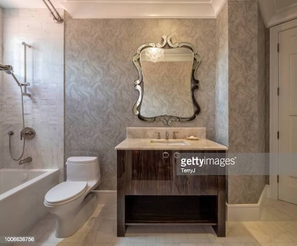 beautiful remodeled guest bathroom in a condominium - vanity mirror stock pictures, royalty-free photos & images