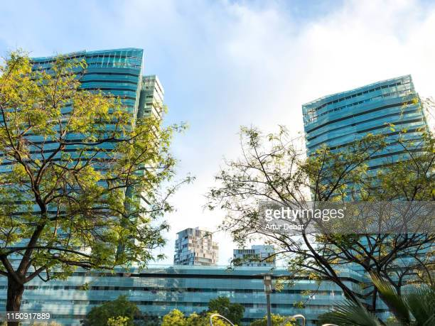 Beautiful residential towers in Barcelona city in front of the sea with nature.