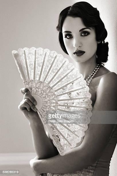 Beautiful retro woman with fan