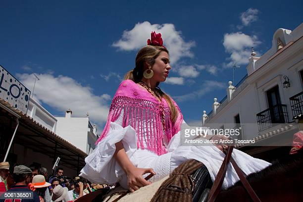 CONTENT] Beautiful rider on horseback waiting to make the presentation of his Brotherhood in front of the Virgin of El Rocio dressed in traditional...